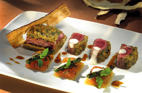 Fillet of lamb topped with parmesan cheese, warm eggplant chutney with mint, tomato preserve and gri